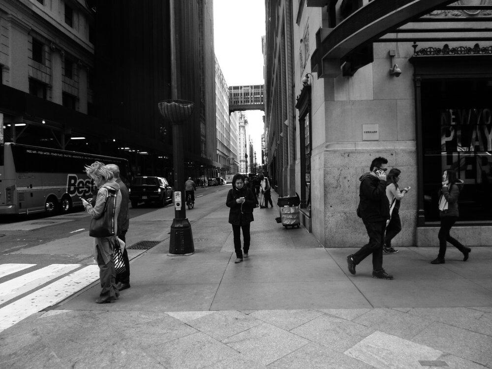 Kyle Hemmings photo City of Love black and white people on phones in Philadelphia in Backchannels Journal