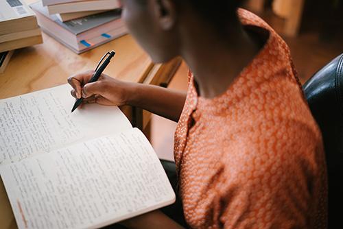 Woman writing - Backchannels Journal, literary journal in Cedar Rapids, Iowa